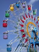 picture of amusement park rides  - A colourful ferris wheel in Vietnam - JPG