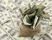 pic of sack dollar  - Canvas money sack with one hundred dollar bills - JPG