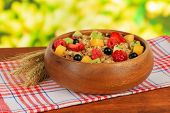 stock photo of lenten  - Oatmeal with fruits on table on bright background - JPG
