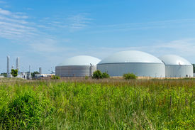 stock photo of biogas  - A biogas plant under a blue sky - JPG