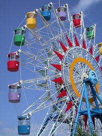 foto of amusement park rides  - A colourful ferris wheel in Vietnam - JPG