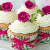 Cupcakes decorated with pink sugar roses