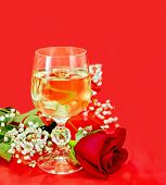 Wine In A Glass With A Rose