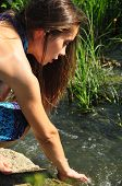 Beautiful woman washing at the river