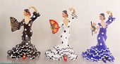 Three ornamental female flamenco dancers in