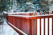 Wooden Fence In Winter