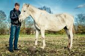 pic of beast-man  - Young man with beautiful horse outdoors - JPG