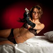 Beautiful Lady In Lingerie  With Gun