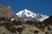 Chulu and stupa, view from Nawal, Nepal