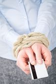 Businesswoman With Tied Hands And A Credit Card