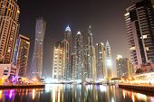 Dubai, Uae - September 11: The Cayan Tower In Night Illumination At Dubai Marina On September 11, 20