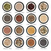 Large seed super food selection in  porcelain bowls over slate rounds and white isolated background