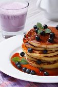 Blueberry Pancakes With Maple Syrup And A Cocktail Close-up