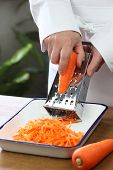 making grated carrot salad, shredding carrots