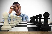 Composite image of thinking casual businessman with chessboard