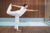 picture of shiva  - Content brunette in white in the shiva posture in health spa - JPG