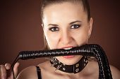 mistress with a whip in the mouth