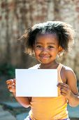 Cute African Girl Holding White Blank Card.
