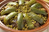 Traditional Moroccan dish with lamb, peas and courgette close up