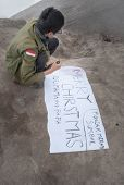 Unidentified Indonesian Student Write Poster For Pictures On The Top Of Volcano Merapi
