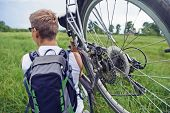 Cyclist Man Carries Bike In Field