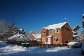 Detached House In Snow With Blue Sky