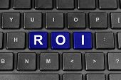 Roi Or Return On Investment Word On Keyboard