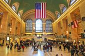 picture of hustle  - Grand Central terminal in New York City with motion blurred travelers - JPG