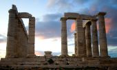 Temple Of Poseidon On Sounion Cape In Greece At Sunset. The Southernmost Point Of The Attica Peninsu