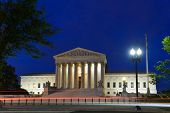 United States Supreme Court Building at night in Washington, DC