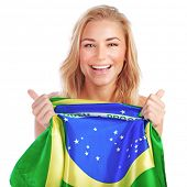 Portrait of happy woman with Brazilian flag isolated on white background, excited fan of Brazil foot