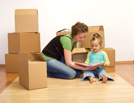 stock photo of mother child  - Unpacking in our new home  - JPG