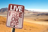 Live Free Or Die sign with a desert background