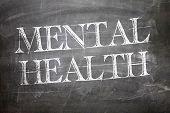 stock photo of antidepressant  - Mental Health written on blackboard - JPG