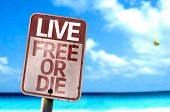 Live Free Or Die sign with a beach on background
