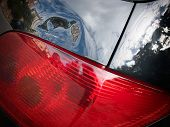 picture of buff  - Dented tailgate of a car above the rear light - JPG