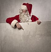 Santa Claus pointing out something