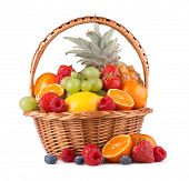 ripe fresh fruits in a basket isolated on white background