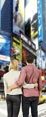 Young couple in a big city, looking at overwhelming billboards, screaming their product and marketing advertisements.