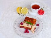 Cheese casserole with raisins and mint on plate over white napkin