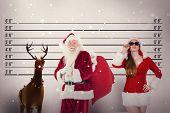 Santa carries his red bag against mug shot background