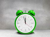 picture of count down  - Alarm clock counting down to twelve against grey room - JPG