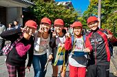 KYOTO, JAPAN-OCT 24,2014: Japanese school children with red caps  laughing in the street on Oct 24, 2014, Kyoto, Japan.