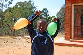 An African Child Plays With Colored Balloons-pomerini-tanzania-africa