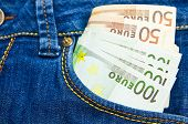 A Lot Of Euro Money In A Pocket Of Jeans Trousers