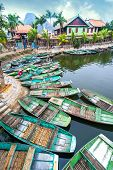 foto of conic  - Vietnamese woman with conical hat Amazing morning view with Vietnamese boats at river - JPG