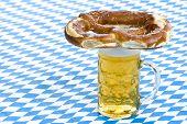 Bavarian Oktoberfest pretzel is lying on beer stein (Mass)