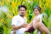 Happy Asian Couple Play Together With Bubble Garden