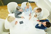 Business team talking about strategy in meeting in conference room