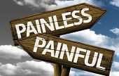 image of anesthesia  - Painless x Painful creative sign with clouds as the background - JPG